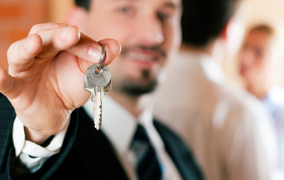 Image of man handing over a key