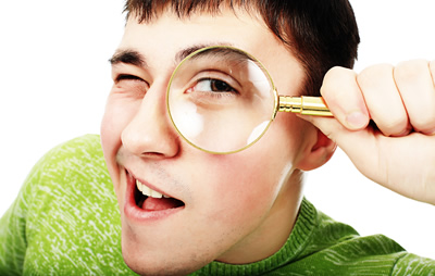 What to look for - image of man looking through magnify glass